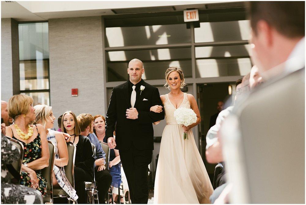 bridesmaid-groomsmen-walking-down-aisle-grand-wayne-center-fort-wayne-indiana
