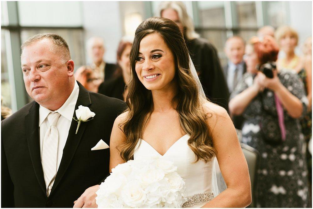 bride-father-walking-down-aisle-smiling-center-wedding-fort-wayne-indiana