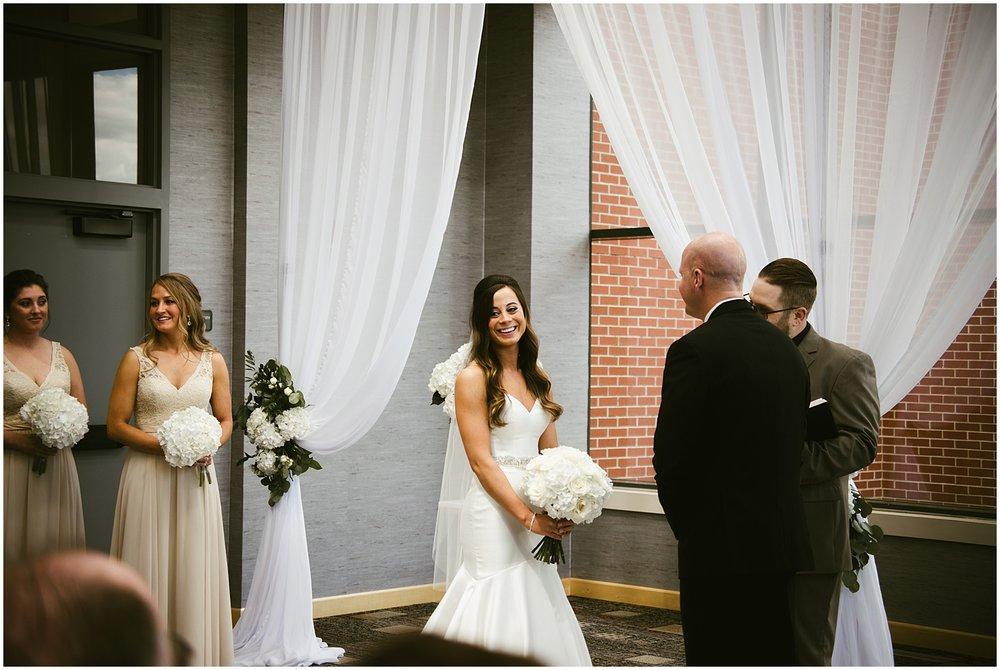 bride-smiling-at-altarbride-father-embracing-aisle-center-wedding-fort-wayne-indiana