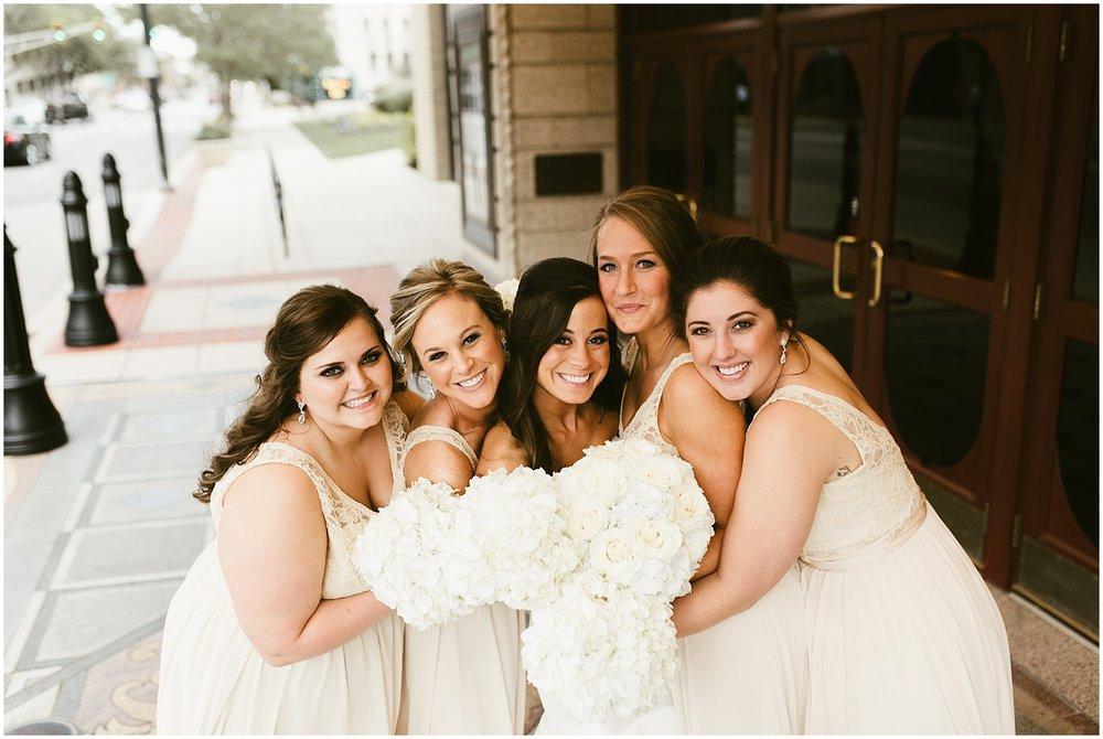 bride-bridesmaid-embracing-bouquets-embassy-theatre-reception-wedding-fort-wayne-indiana