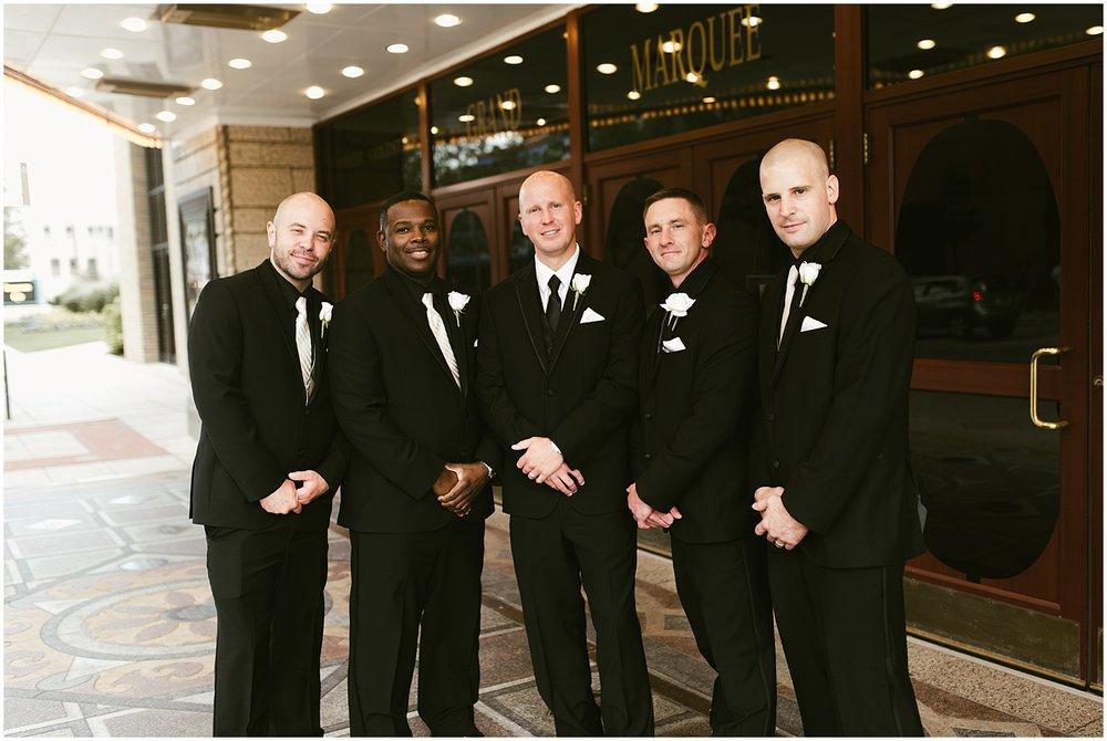 groom-groomsmen-smiling-embassy-theatre-reception-wedding-fort-wayne-indiana