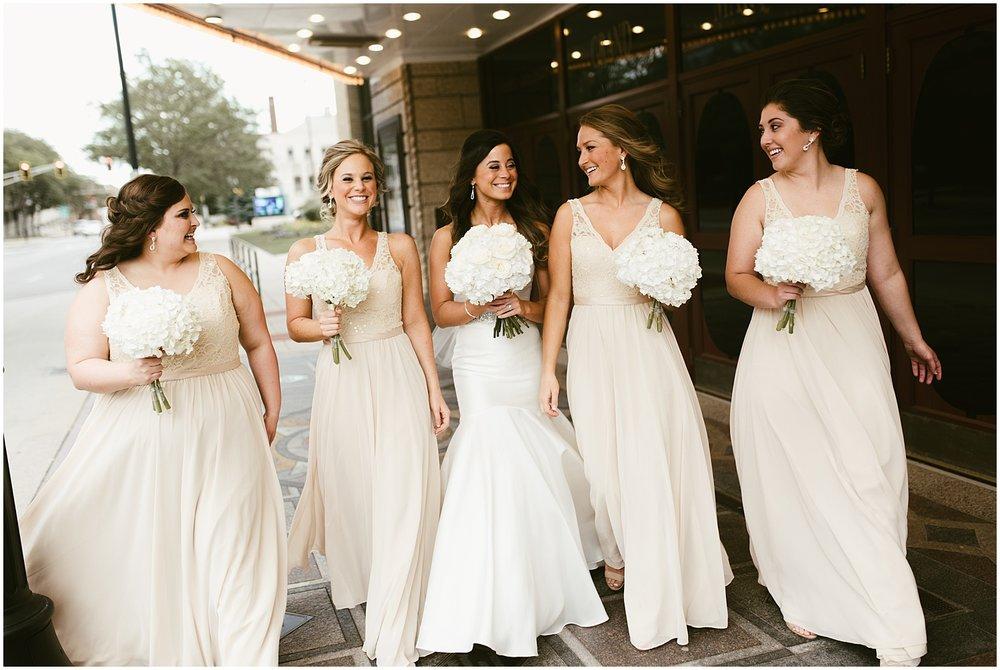 bride-bridesmaids-walking-embassy-theatre-reception-wedding-fort-wayne-indiana