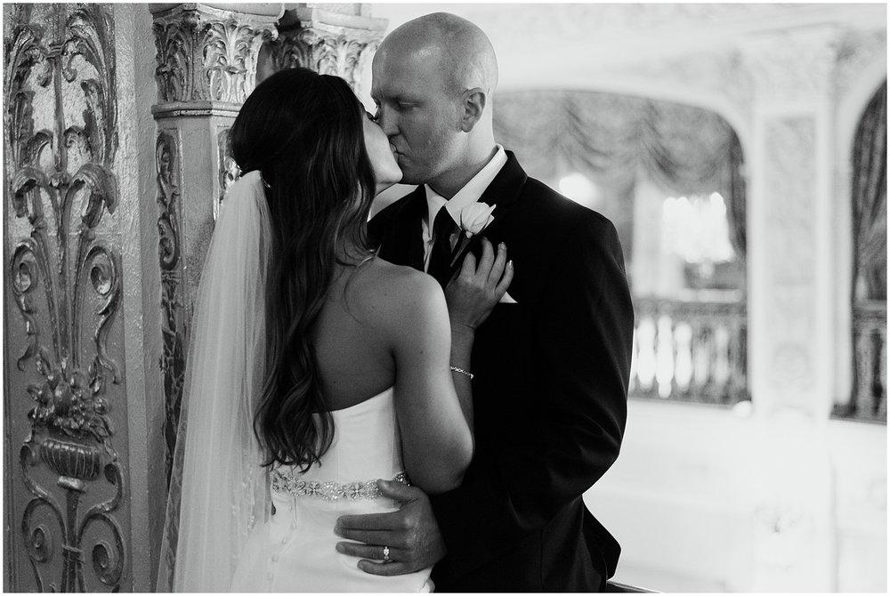 groom-bride-kissing-embassy-theatre-lobby-romantic-wedding