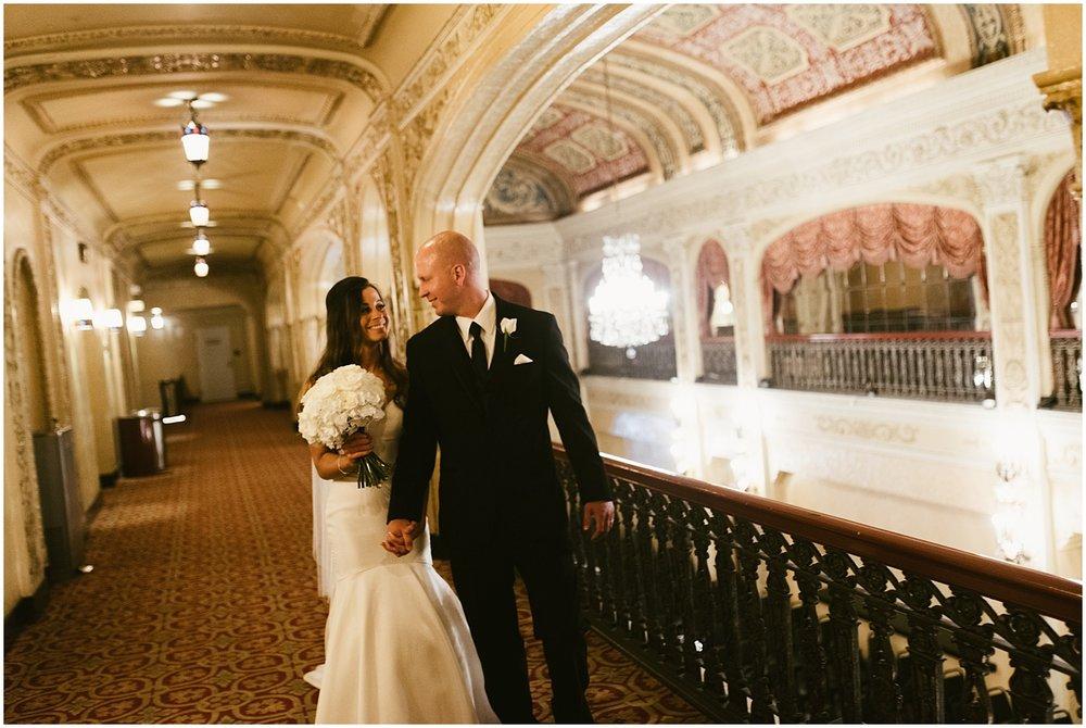 bride-groom-walking-embassy-theatre-lobby-romantic-wedding