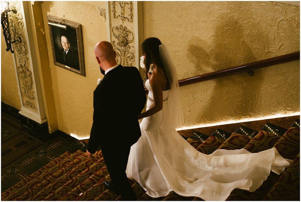bride-groom-on-stairs-embassy-theatre-lobby-romantic-wedding
