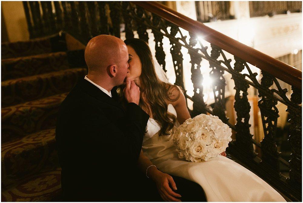 bride-groom-kissing-stairs-embassy-theatre-lobby-romantic-wedding