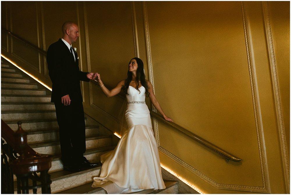 bride-groom-walking-downstairs-embassy-theatre-lobby-romantic-wedding