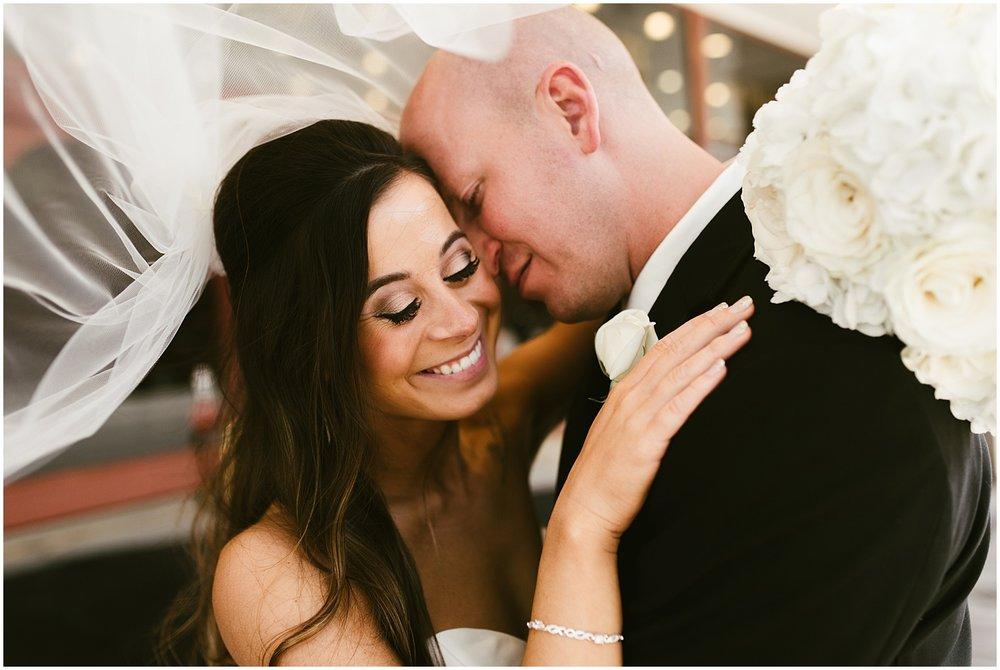 groom-kissing-bride-cheek-embassy-theatre-romantic-wedding