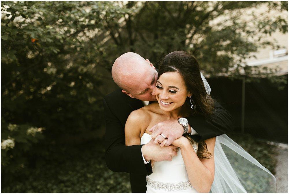 downtown-fort-wayne-wedding-bride-groom-embracing-indiana-photographer-2