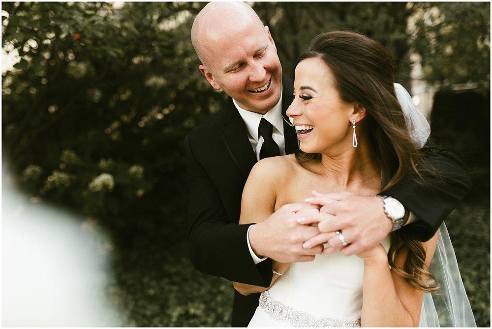 downtown-fort-wayne-wedding-bride-groom-embracing-indiana-photographer-3