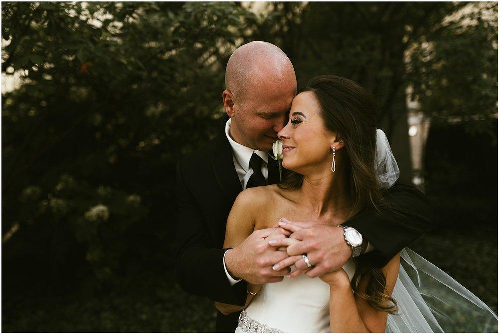 downtown-fort-wayne-wedding-bride-groom-embracing-indiana-photographer-4