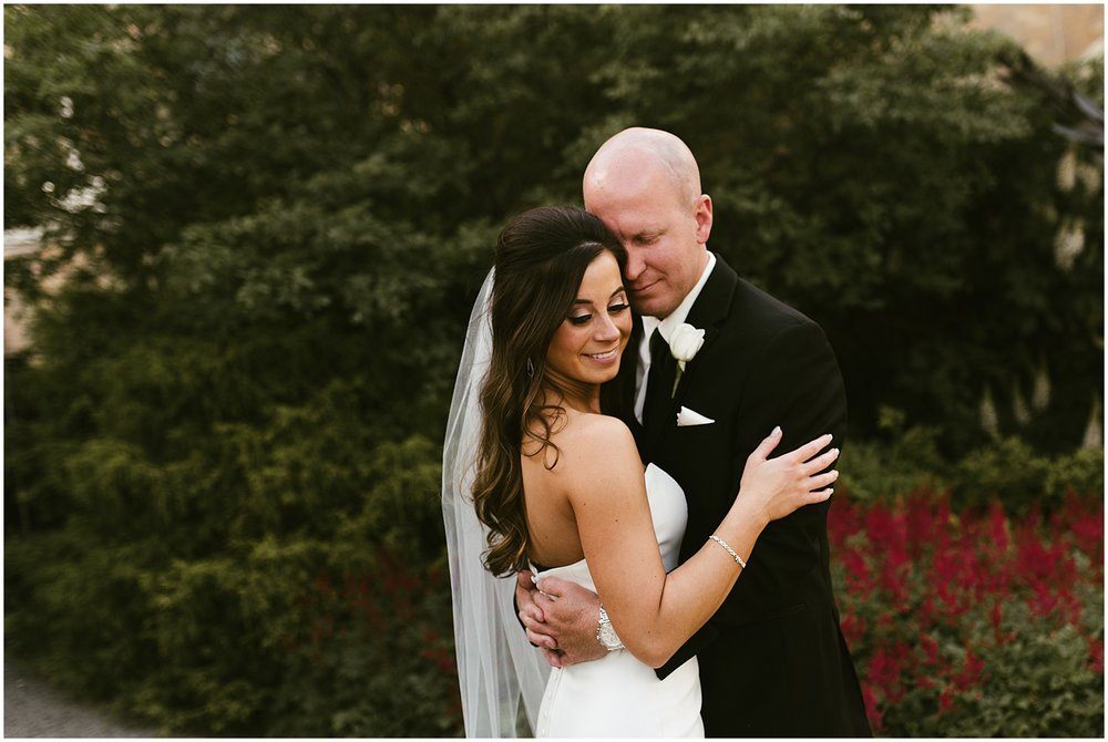 fort-wayne-botanical-garden-wedding-bride-groom-embracing