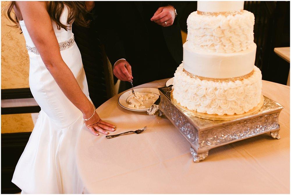 bride-groom-cutting-cake-embassy-theatre-ballroom-fort-wayne-indiana-wedding-photographer