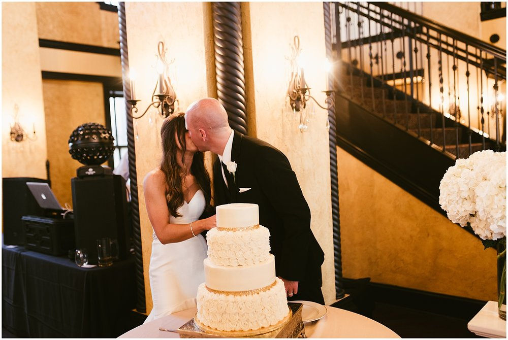 bride-groom-kissing-cake-canvas-cutting-cake-canvas-cutting-embassy-theatre-ballroom-fort-wayne-indiana-wedding-photographer