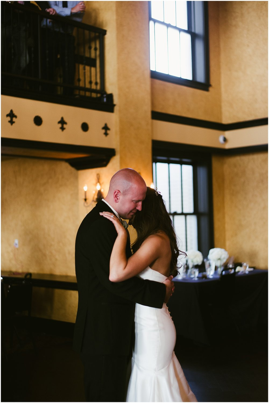 bride-groom-first-dance-embracing-embassy-theatre-ballroom-fort-wayne-indiana-wedding-photographer