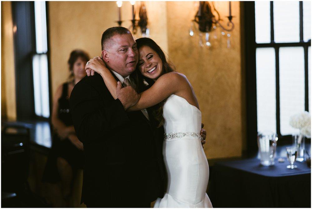 bride-father-embracing-first-dance-embassy-theatre-ballroom-fort-wayne-indiana-wedding-photographer