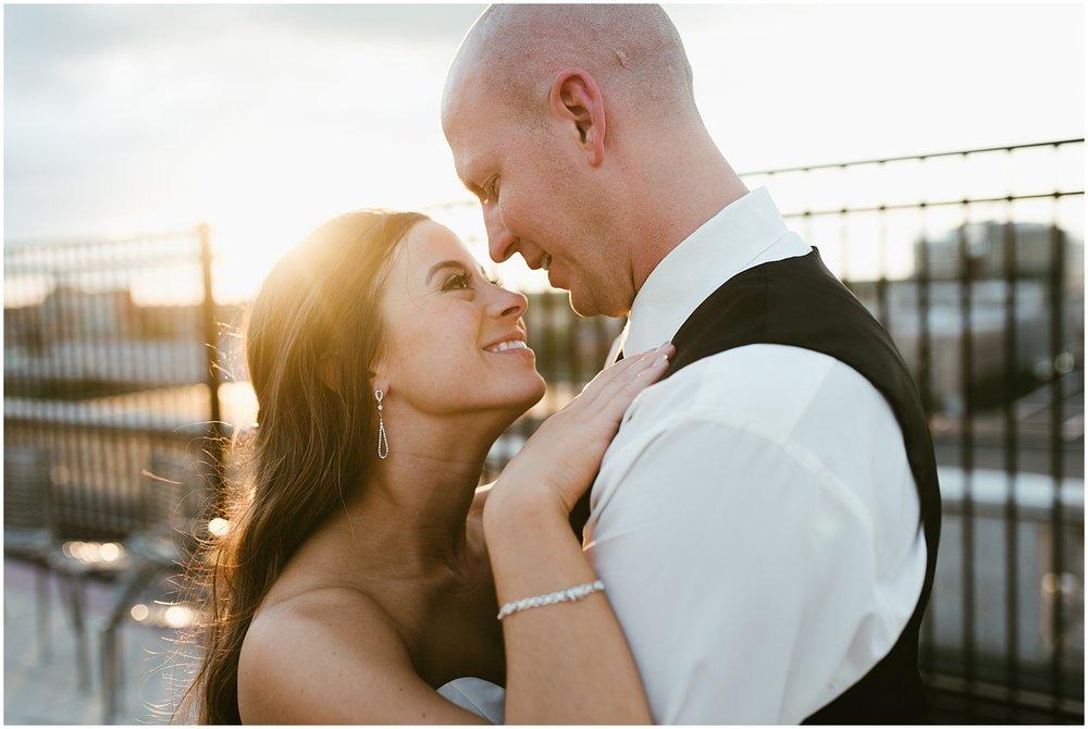 smiling-romantic-bride-groom-embassy-theatre-wedding-sunset-rooftop-bar-fort-wayne-indiana