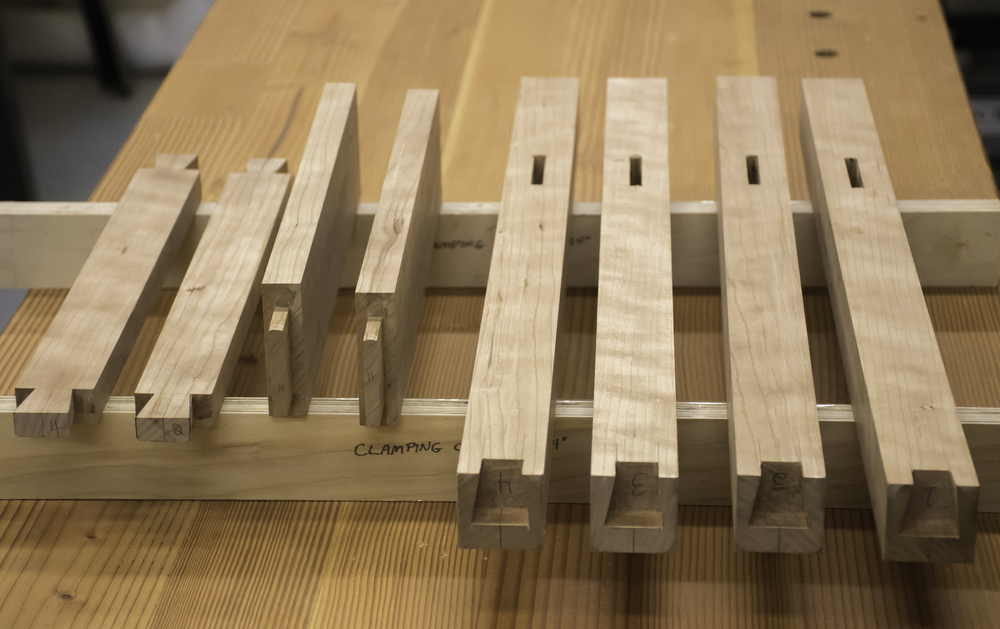 Mortise-and-tenon and dovetail joints have been cut and fitted.