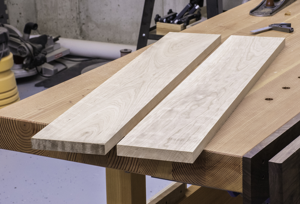 Two boards of sappy cherry serve as the top of the sawbench.