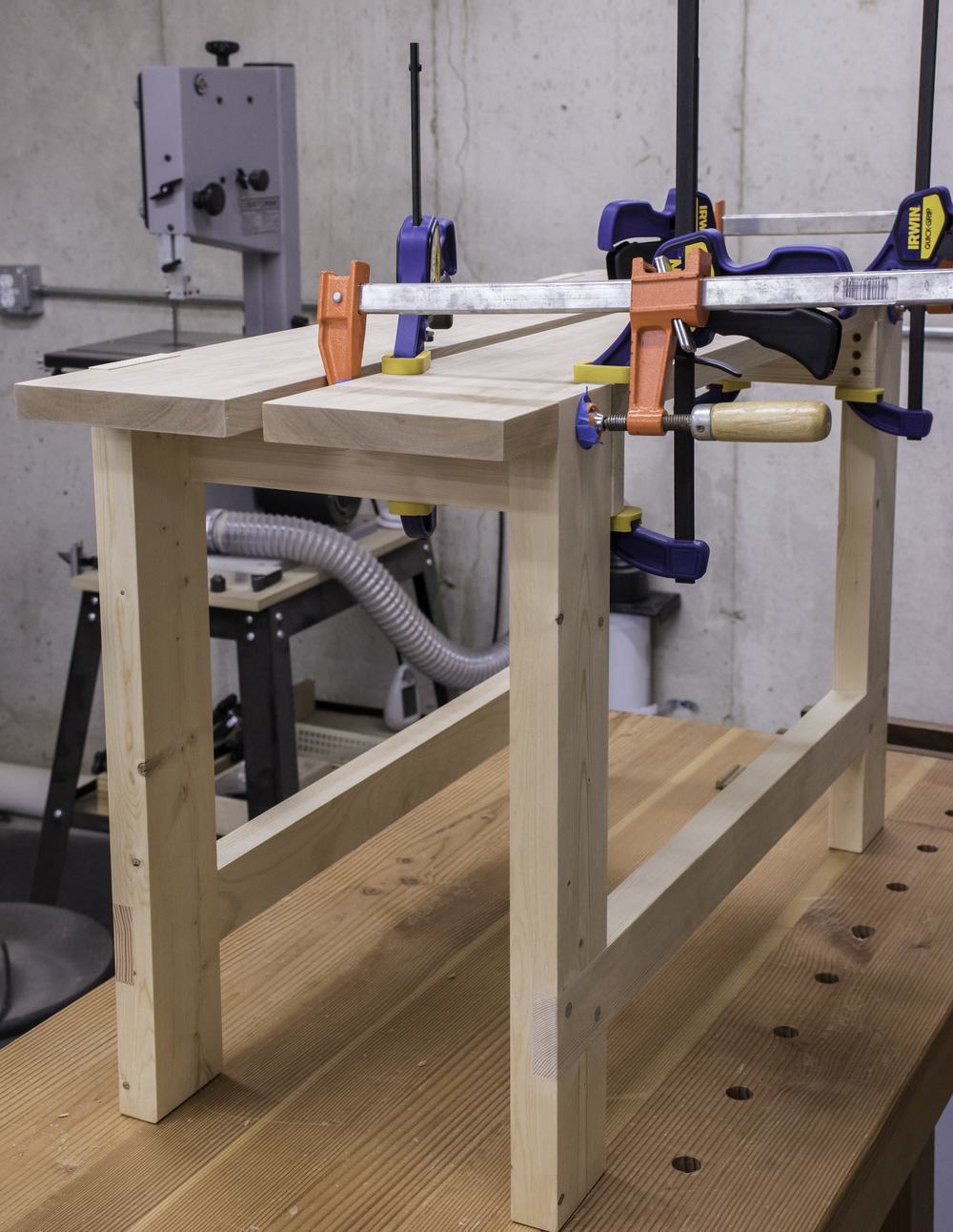 Gluing the top boards to the legs.