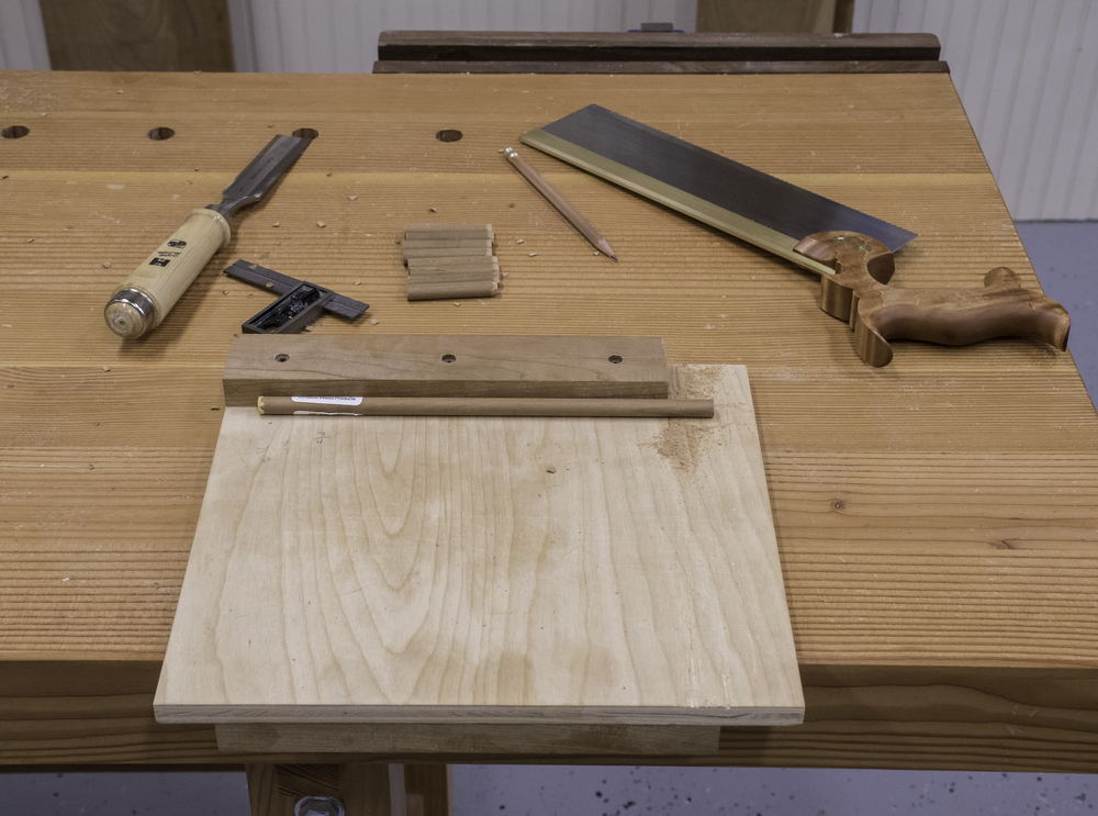 """Cutting down a 3/8"""" cherry dowel rod. I tapered each dowel slightly with a chisel to make it easier to drive it into the joint."""