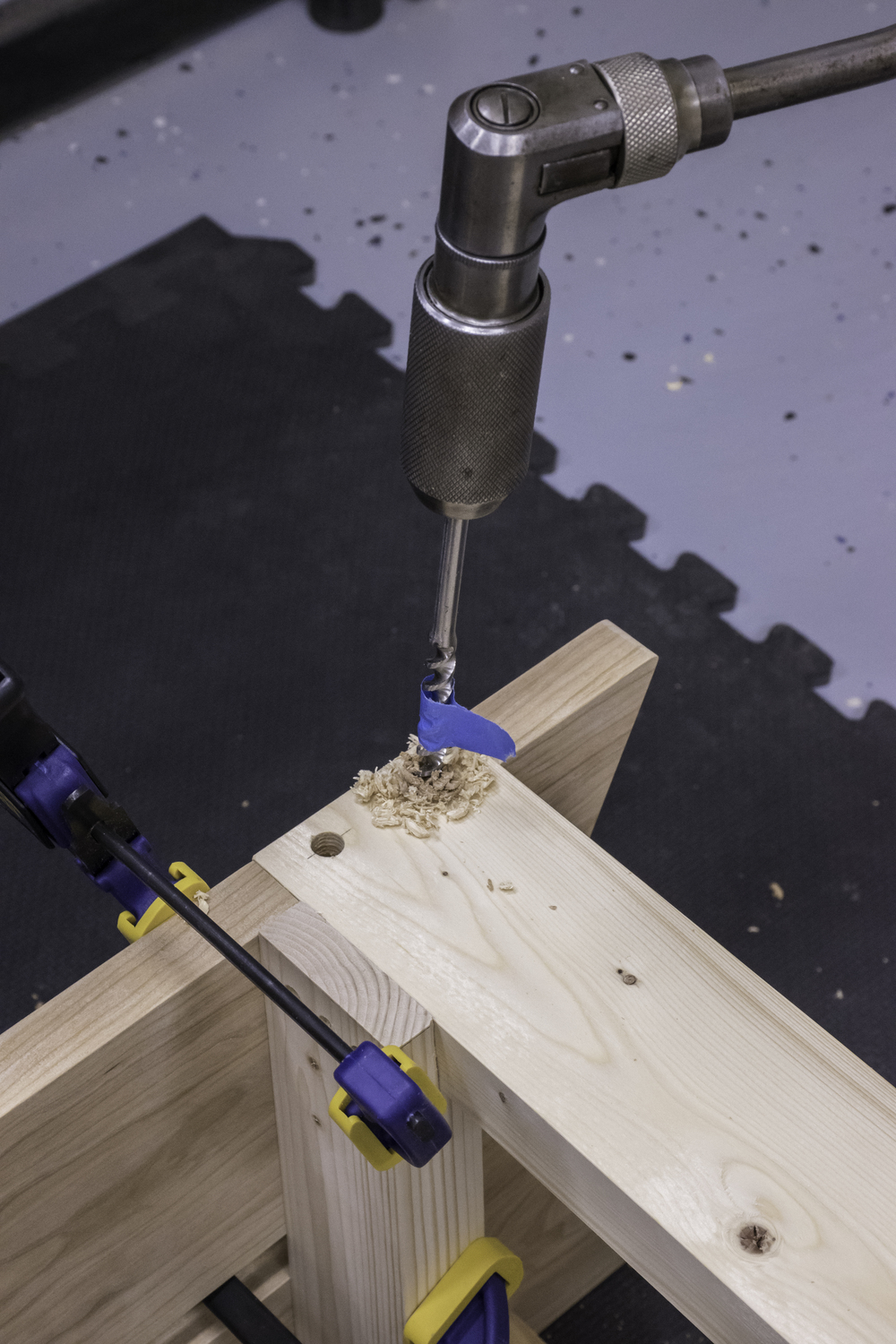 Boring the holes for the dowels.