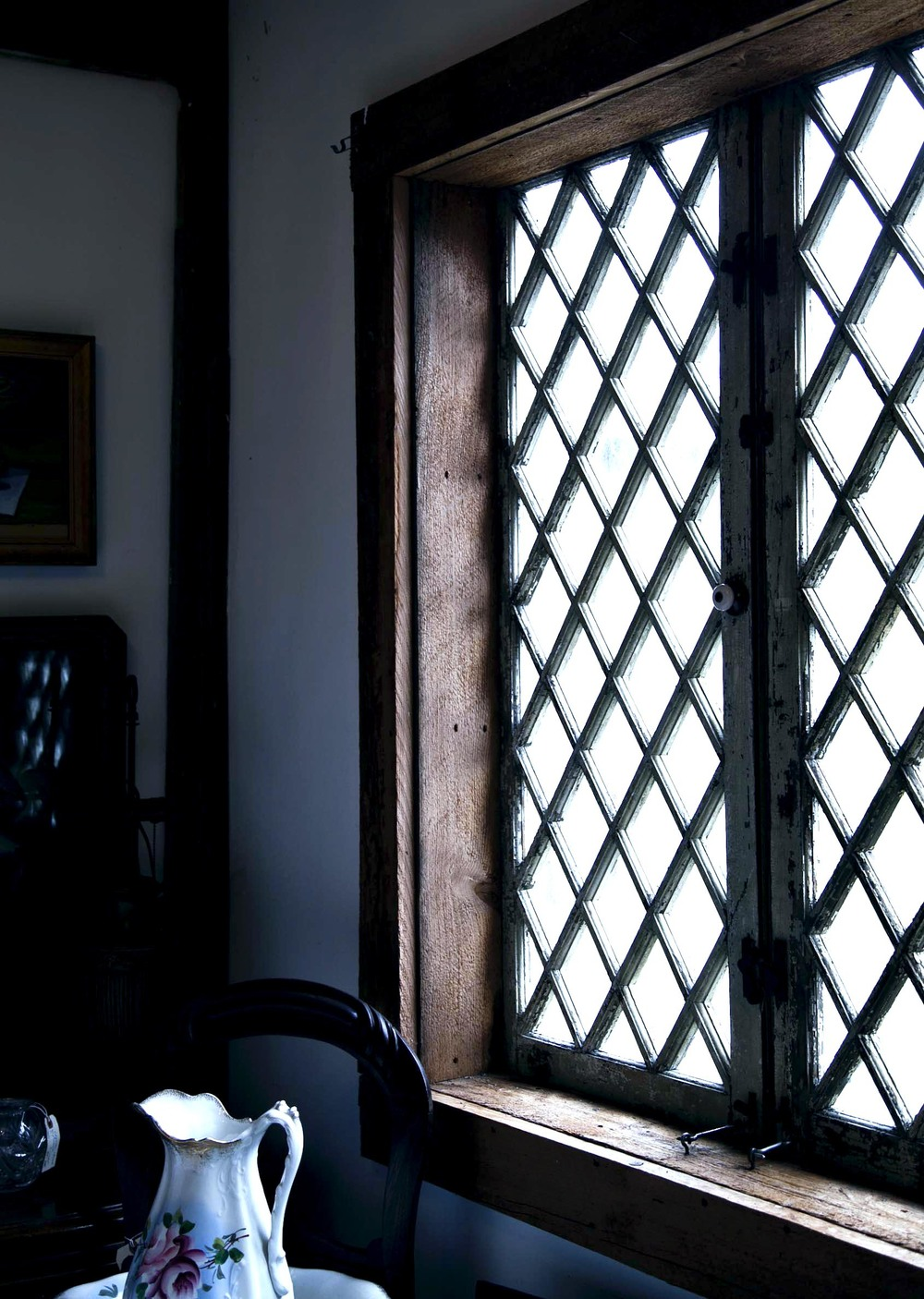 Original wood casing and lattice windows are the details that really warm up this space