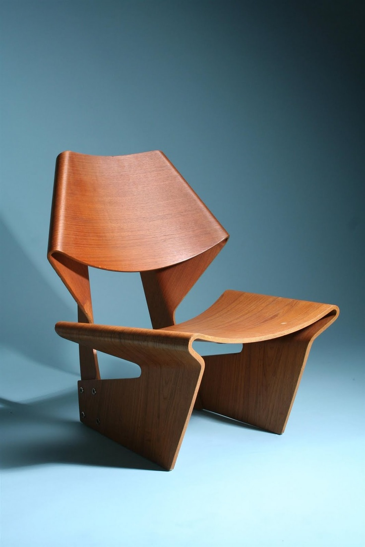 Grete Jalk, Plywood GJ Chair  (1963) , is considered Jalk's best known work.  Still in production -  Get it  HERE