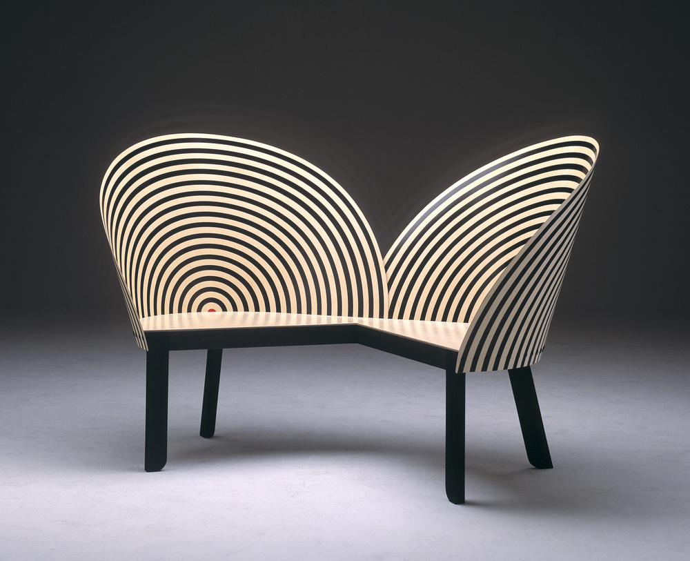 "Nanna Ditzel, Bench For Two (1989)  Ditzel, otherwise known as the ""First lady of Scandinavian Design"", like other women in her generation, came up during time when the field was mostly male dominated.  Trained as a cabinetmaker at the Royal Academy of Fine Arts, her work was multifaceted to include jewelry, ceramics and textiles. Read more of her story  HERE"