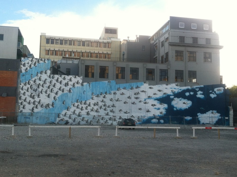 Large scale mural on torn-down building