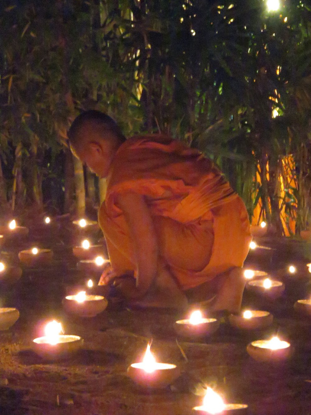 Monks lighting the MANY tea lights