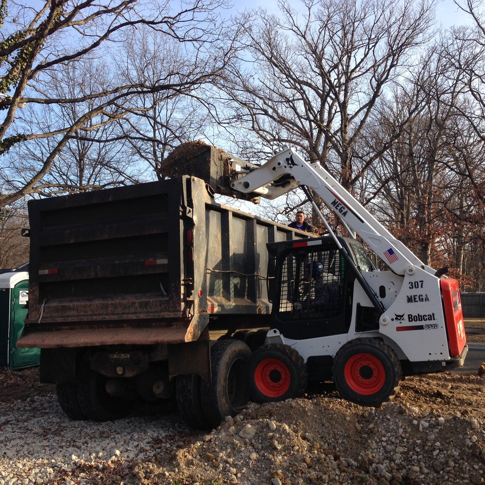 A temporary ramp was made for the Bobcat to be able to load into the dump truck.