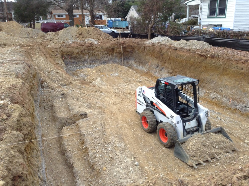 As can be seen there are three elevation heights that have been excavated. The deepest excavation is for the footings and for the location for the sump basin on the left hand side. The Bobcat is finishing removing the dirt from the slab elevation.