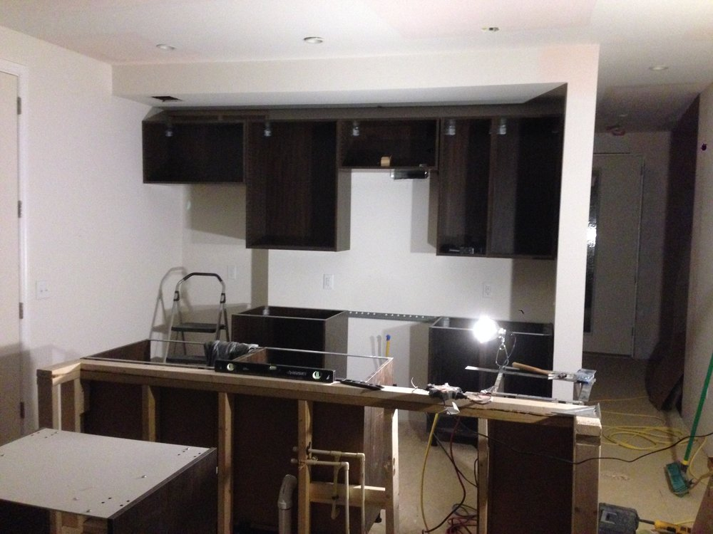 Kitchen cabinet boxes installed and ready for counter top measurements.