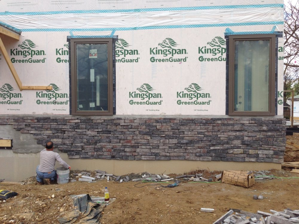 Stone siding slowly making progress. There are only two guys working so it should take another 5-8 days. I see an end in site!