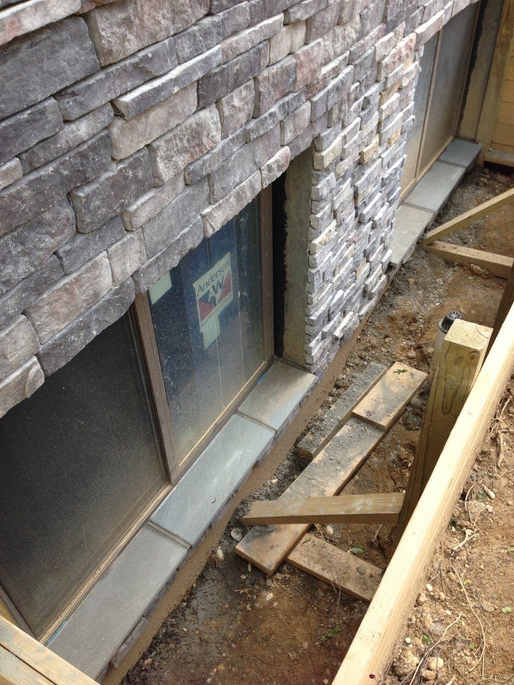 Stone sill installed. I should have used this flagstone for the water table and saved some money. Always learning.