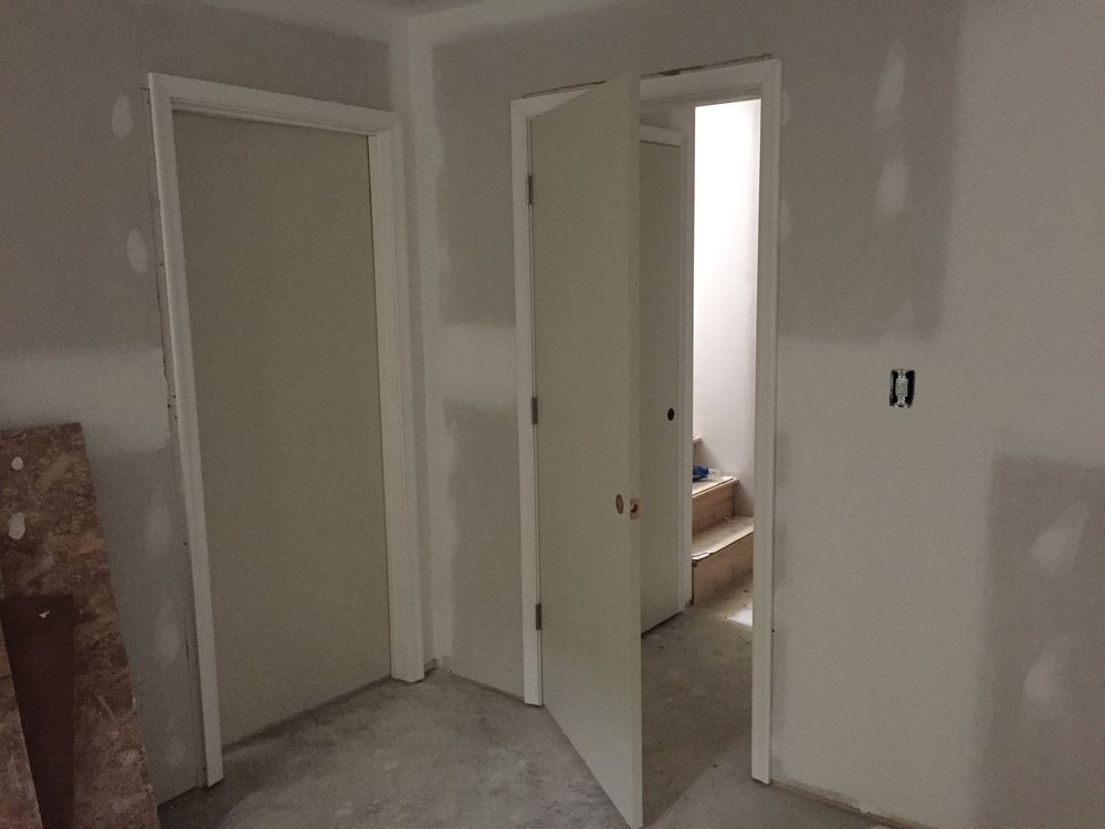Doors installed. I also realized that I now need door knobs! More money. My next home is going be on the beach with 75 degree weather year round and I'm only building a platform with a roof. No walls or doors or windows. Just an open space and that is it. Pee in ocean and cook on a grill.