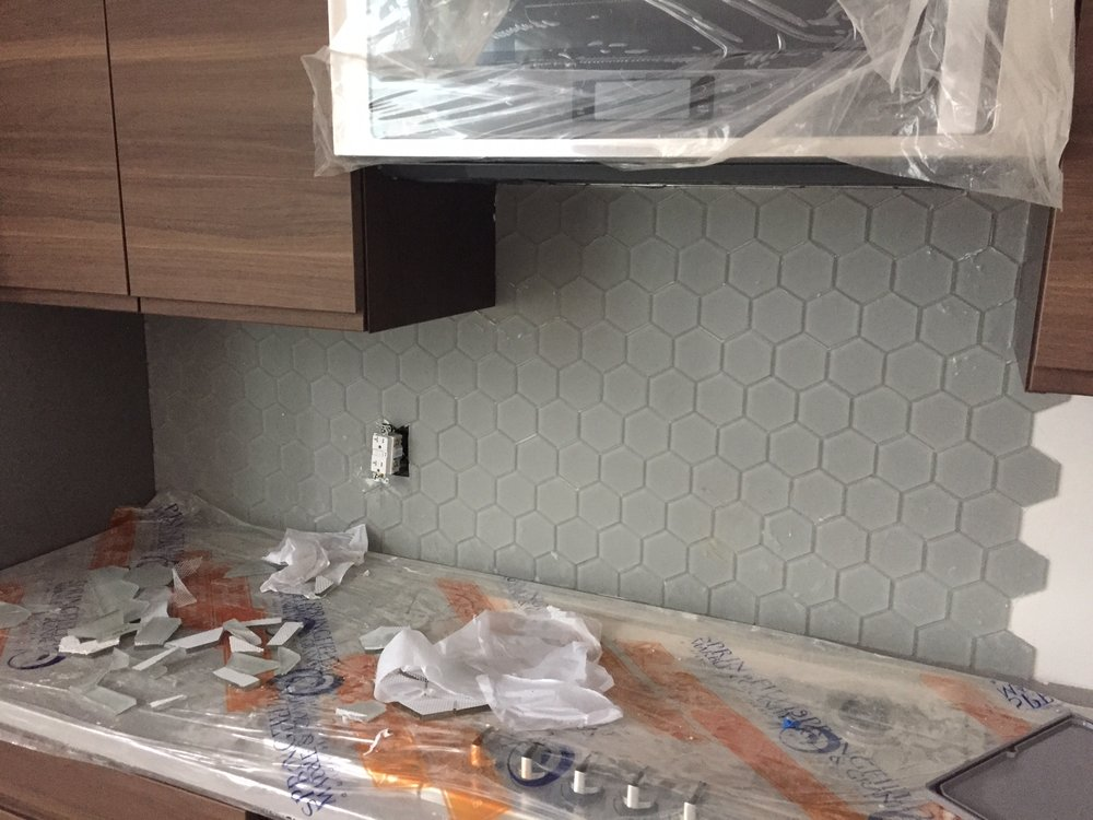 Almost enough tile for the kitchen back splash. We bought two boxes but I guess it was not enough. I can't wait to cover that in grease!