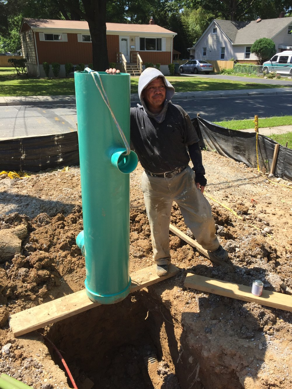 "The 12""  Nyloplast drain and Rudy. All the house water will drain into the 4"" connection up top and exit at the 6"" connection going to the main storm drain line. The drain is over 5' tall."