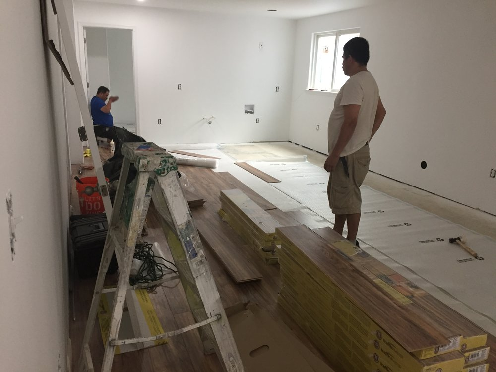 Basement flooring being installed.