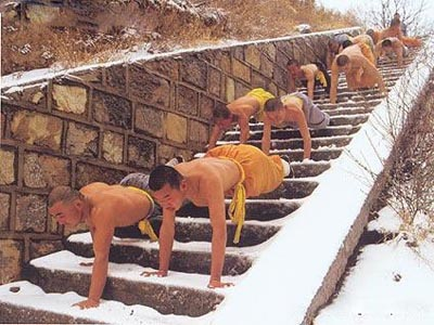 SHAOLIN MONKS PRACTICING WALKING PUSH UP AND DOWN STEPS.