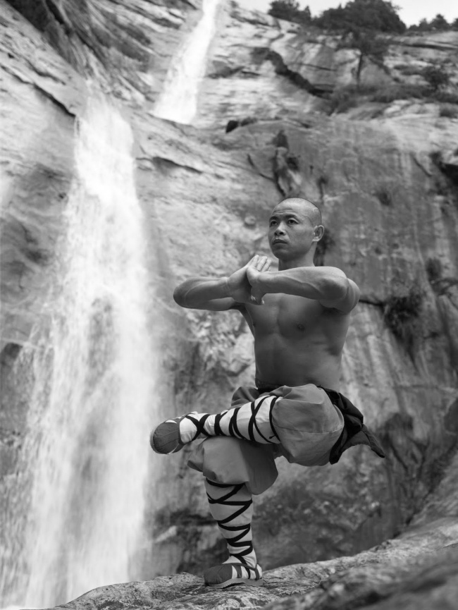 SHAOLIN MONK PRACTICING ONE LEG SQUAT AND MEDITATION.