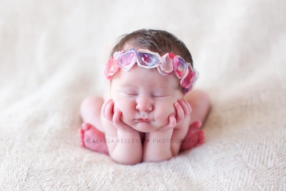 head-in-hands-cheeks-pose-newborn-baby-girl-flower-crown-headband