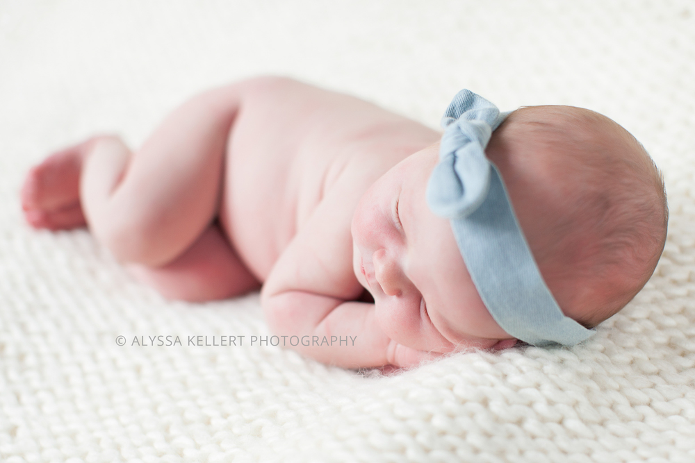newborn-on-white-blanket-denim-bow-headband