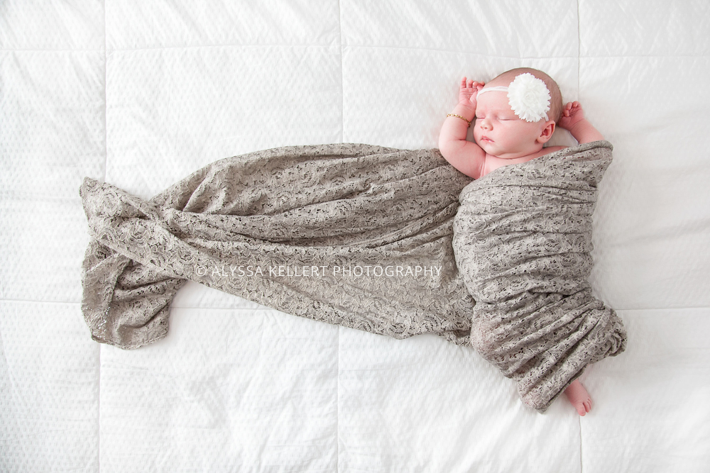 newborn-girl-baby-bed-wrap-photography