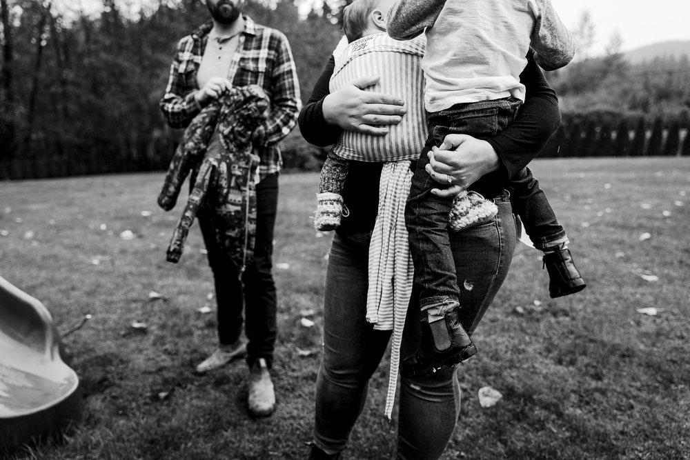 mom-holding-two-kids.jpg