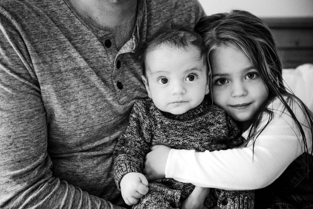 girl-hugging-baby-brother.jpg