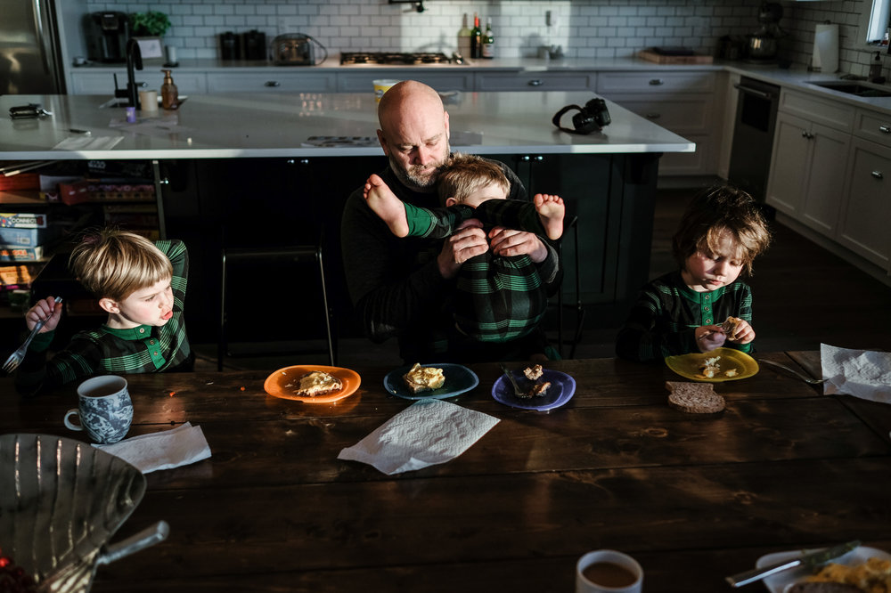 dad-lifting-kid-breakfast-table-photography-documentary-abbotsford