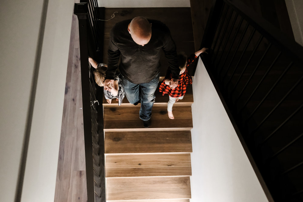 dad-bringing-kids-down-stairs-photography-vancouver