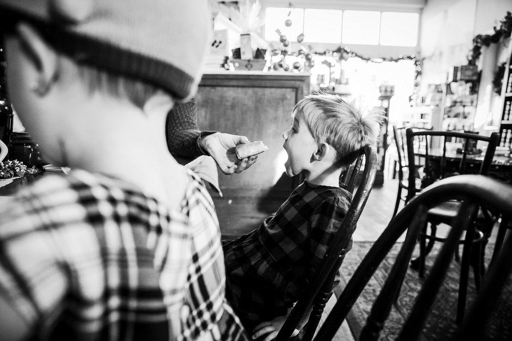 mom-feeding-kid-sausage-roll-abbotsford-candy-store
